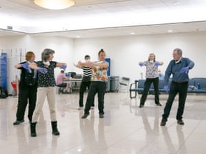 A passenger of the Ocean Atlantic Tom O'Neill instructs fellow passengers in Tai Chi in Santiago airport en route from Uruguay to Sydney.