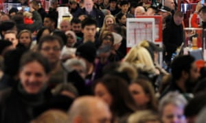 Shoppers make their way to early sales on Black Friday in New York.