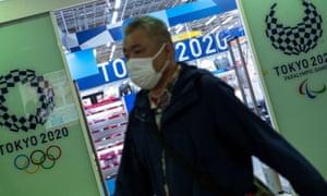 A man walks past a Tokyo 2020 souvenir shop in the Japanese capital