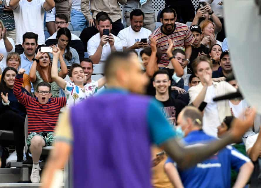 Fans cheer on Nick Kyrgios from the crowded stands on John Cain Arena