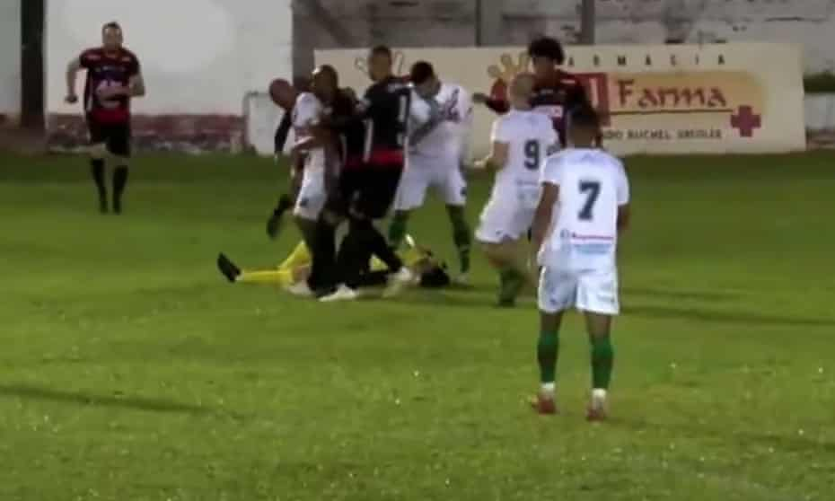 The referee, Rodrigo Crivellaro, goes to ground after being attacked during the match between Guarani and Sport Club São Paulo.