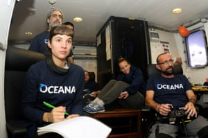 Crew members watching the ROV images. Other areas were observed to be heavily disturbed by human activities, with evidence of bottom trawling, discarded or 'ghost' fishing nets, and extensive infrastructure such as oil platforms, cables, pipelines, and wind farms.