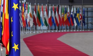 European Union flags displayed at the European Council in Brussels. EU leaders are meeting on Monday to kickstart the process of filling the top jobs