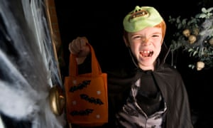 A young trick or treater celebrates Halloween.