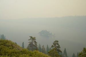 Lake Tahoe's Emerald Bay, on the lake's south side, is enveloped in smoke from the Caldor fire.