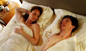 Helen Hunt and John Hawkes lying in bed in a scene from The Sessions