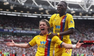 Conor Gallagher of Crystal Palace celebrates after scoring their sides second goal with team mate Christian Benteke.