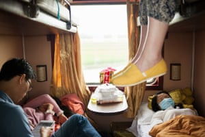 Train from Hội An to Ho Chi Minh, Vietnam, by Charlotte Sverdrup  'My friend and I travelled in a shared sleeper carriage and spent more than 20 hours on the train,' says Sverdrup. 'My friend's feet dangled over the edge of the top bunk as I took the picture from the hallway.'