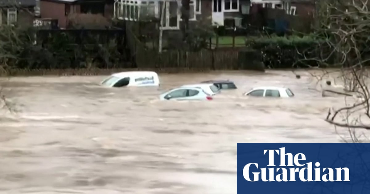 Storm Dennis: cars swept away by flooding in Wales – video