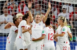 England's Lucy Bronze celebrates scoring their third goal with teammates.