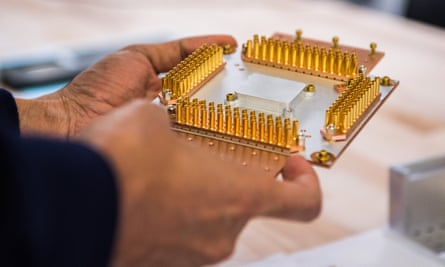 Pichai holds a component of the quantum computer