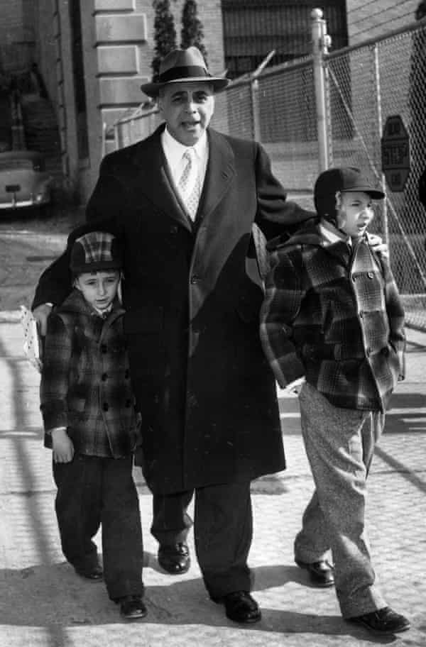 The Rosenbergs' lawyer Emanuel Bloch with Robert and Michael in 1953 outside Sing Sing prison in New York state, where they used to visit their parents.