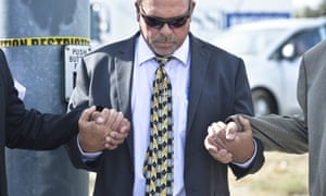 Dec. 3, 2015 - Attorney Michael Maddux prays at an intersection near the site of the mass shooting in San Bernardino, California, that left 14 dead and 21 others injured. Image by © Stuart Palley/ZUMA Press/Corbis
