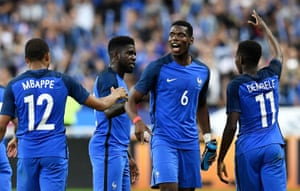 Paul Pogba celebrates the third goal with Dembele and Mbappé.