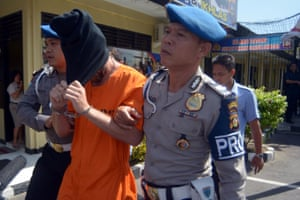 David Taylor is escorted by police in Denpasar