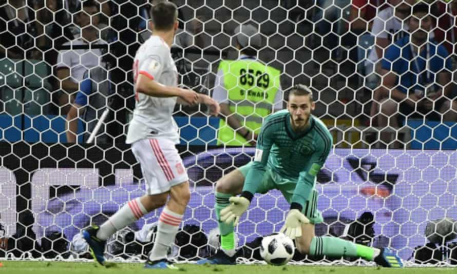 David de Gea looked to have Cristiano Ronaldo's shot covered but let it creep past him during Spain's 3-3 draw with Portugal at the 2018 World Cup.