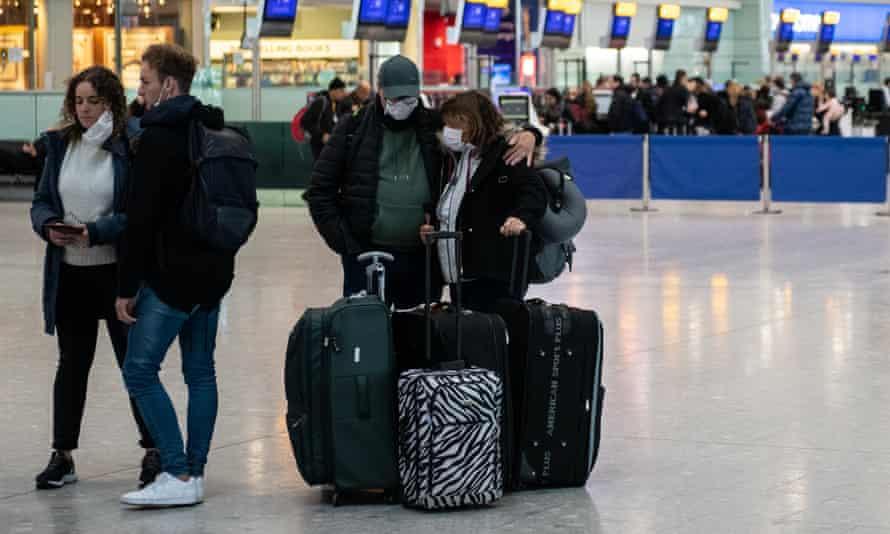 Airline passengers wait