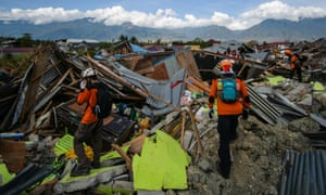 An Indonesian search and rescue team walk amongst the debris in Petobo. Thursday will be the official deadline for recovering bodies.