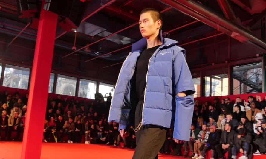 A model wears an Off-White oversized puffer jacket.
