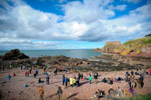 Competitors and visitors gather at the 2018 European Stone Stacking Championship in Dunbar, Scotland.