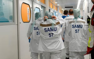 French doctors walk at the corridor of the isolation station at the University hospital Essen, Germany, on 1 April.