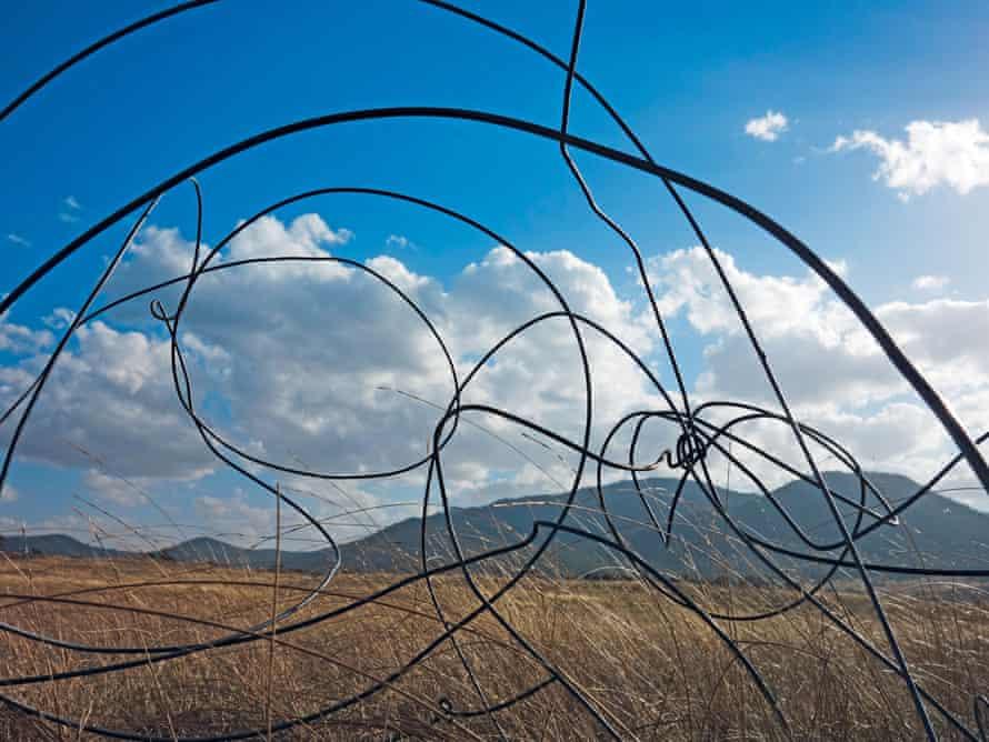 Curls of wire over the grasslands near Namadgi