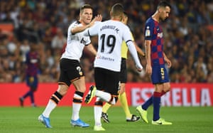 Kevin Gameiro and Rodrigo combines well to score during Valencia's defeat at Barcelona on Saturday.