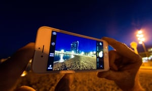 An iPhone late at night on the beach.