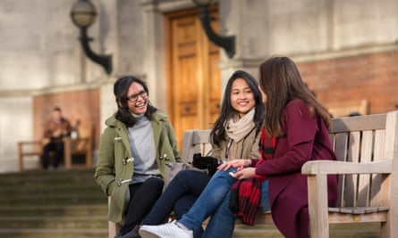 Three girls laughing in front of imperial college london