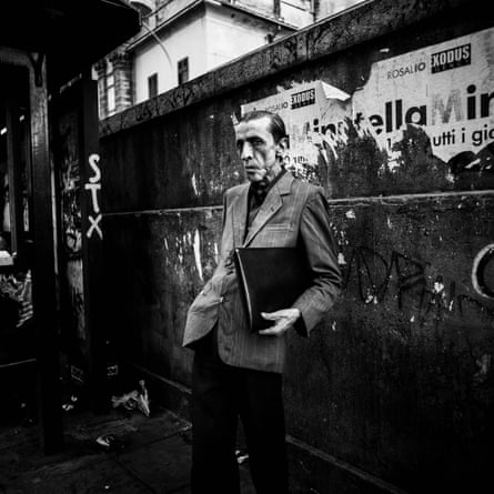 'A sustained atmosphere of unease': a man waiting for the bus in Palermo, from Mimi Mollica's Terra Nostra.