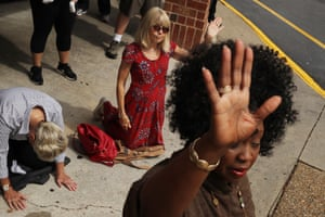 Prayers take place in a car park after a mass shooting in Virginia Beach, US