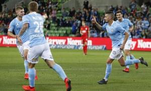 Jamie Maclaren celebrates with Melbourne City teammates