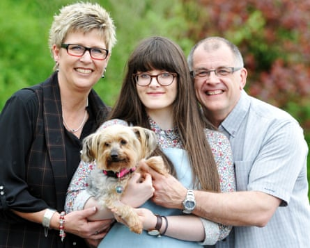 Sandra, Emma and Peter Wright reunited with their yorkshire terrier Eddie.