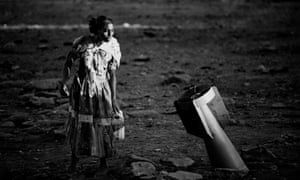 A woman looks at a government cluster bomb in Tigray in 1989 during the Ethiopian Civil War.
