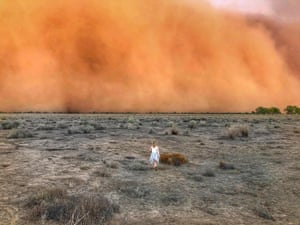 A child runs towards a dust storm in Mullengudgery, New South Wales.