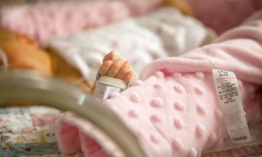 A premature baby in an incubator