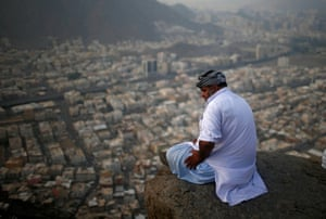 A Muslim pilgrim visits Jabal al-Nour, where Muslims believe the prophet Muhammad received the first words of the Qur'an through Gabriel in the Hira cave, Mecca, Saudi Arabia