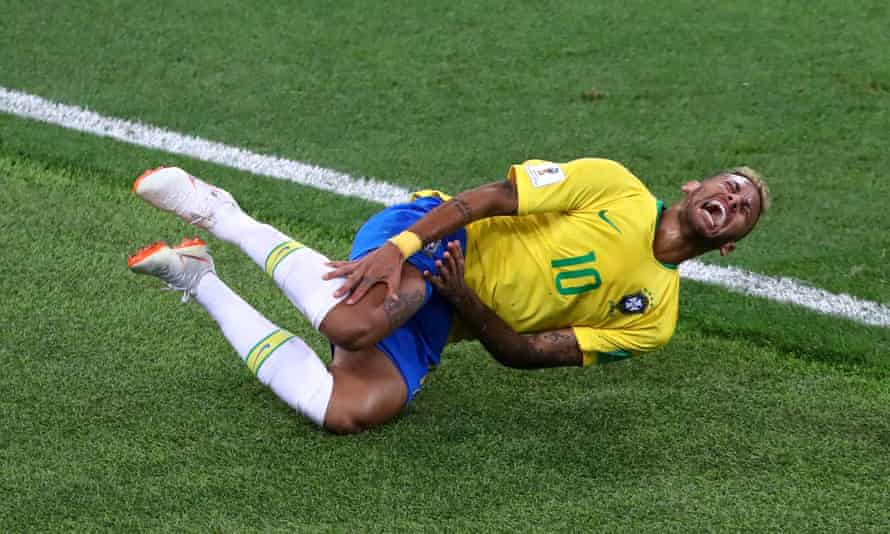 Neymar reacts after a challenge against Serbia.