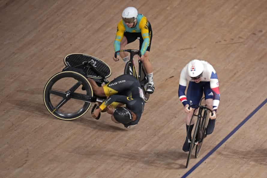 Muhammad Shah Firdaus Sahrom of Malaysia and Sergey Ponomaryov of Team Kazakhstan crash as Jack Carlin rides on.