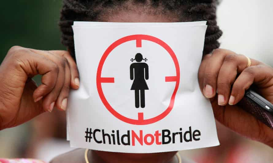 Aa woman protests against underage marriages in Lagos, Nigeria