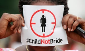 A woman protests child marriage
