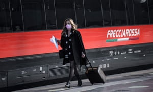 A passenger in a railway station in Milan on Friday