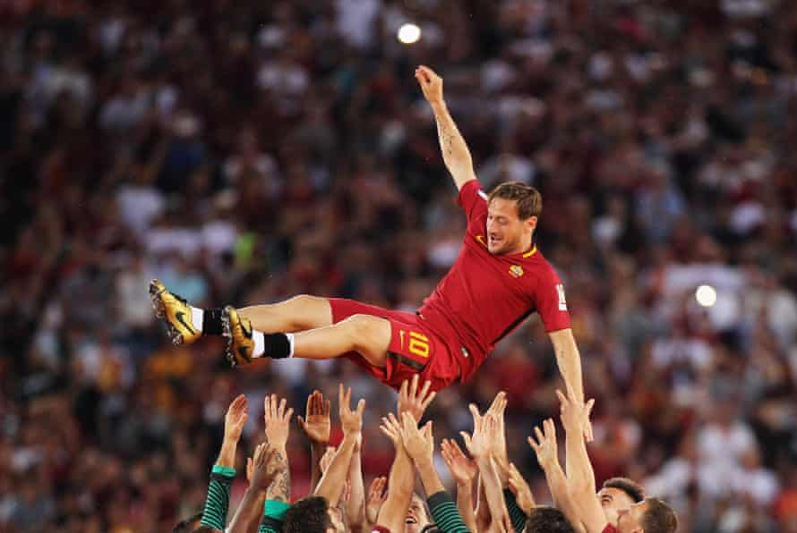 The Roma players hoist up Totti after his last match for the Giallorossi in 2017.