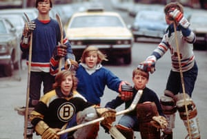 Kids play street hockey in 1976.