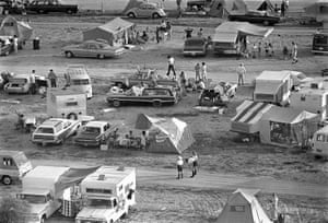 Wednesday 16 July 1969. The early morning sun bathes hundreds of spectators on the beaches and roadways near the NASA Kennedy Space Centre where they had camped the night before