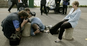 Photographers take pictures of May's shoes outside the Conservative party conference in Bournemouth in 2004