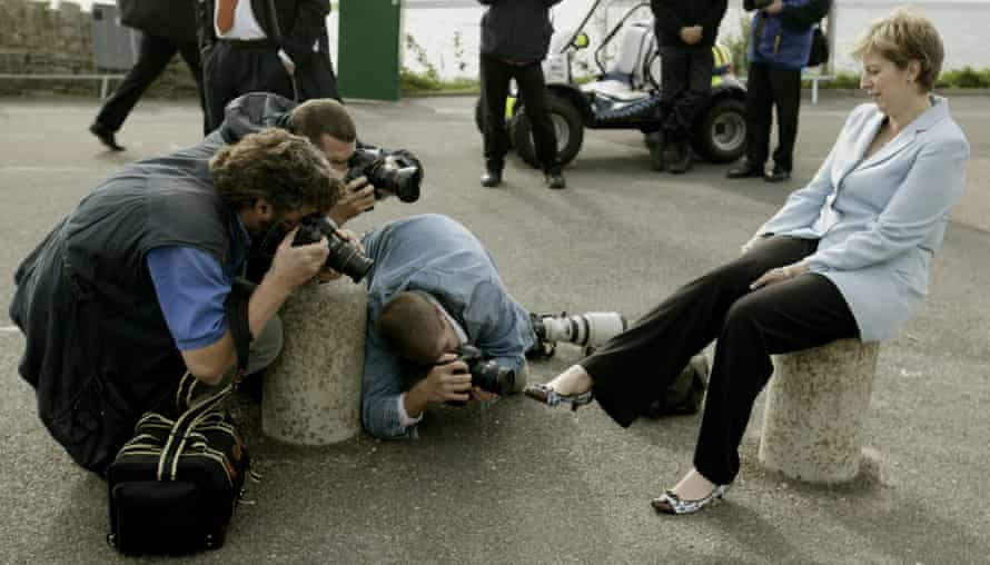 Photographers focus on the shoes on the cliff path at the Conservative party conference in Bournemouth in 2004.