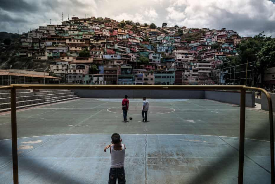 Children play on a football pitch in Mamera, one of the most dangerous slums in Caracas. The lack of food is also causing an educational crisis, since many mothers refuse to take their children to school on an empty stomach