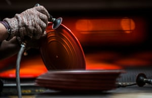 Hand-finishing one of the lids