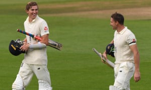Zak Crawley and Jos Buttler leave the field after adding 205 for the fifth wicket on the first day of the third Test against Pakistan.